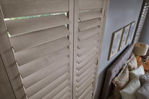 mini shutters in a bedroom